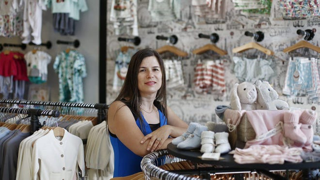 City Style Children's Boutique Owner Dina Solokha, who opened her store one day before Gov. Mike DeWine ordered most businesses to close in March, said she had hoped to build a clinentele before concentrating on online orders.