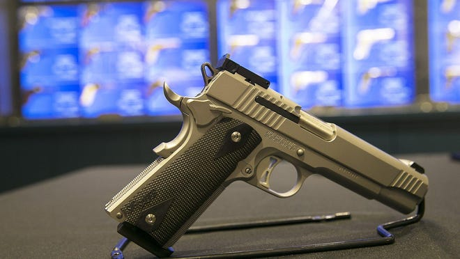 A handgun was on display when Texas Gov. Greg Abbott signed into law Senate Bill 16, lowering the license-to-carry fee, in 2017.