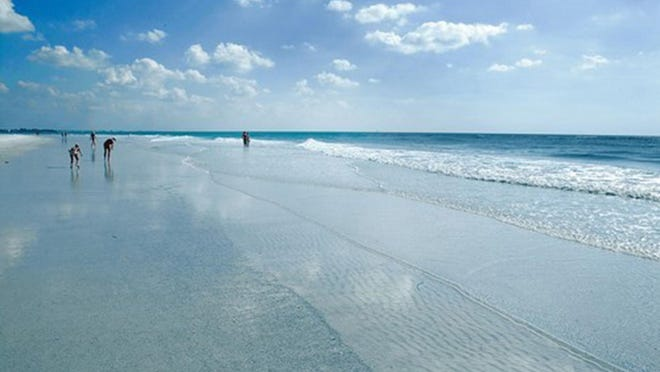 Siesta Beach on Siesta Key southwest of Sarasota, Fla., was named America's top beach in 2011 and 2017 on Dr. Beach's annual Top 10 Beach List. Amid the pandemic, Florida's tourism-marketing agency wants Floridians to become in-state travelers.