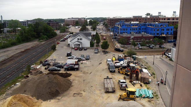 Road work and construction continues on Deer and Bridge streets near the Foundry Place parking garage in downtown Portsmouth.