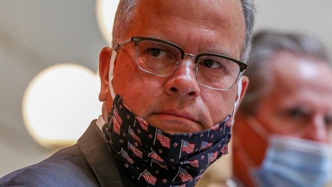 Speaker Nicholas Mattiello lowers his mask to address the House chamber on Wednesday.