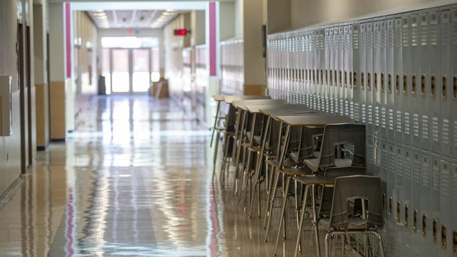 Hallways were empty during the first day of school at Kelly Lane Middle school in Pflugerville on Aug. 13. In-person learning could resume for district schools as soon as Sept. 11.