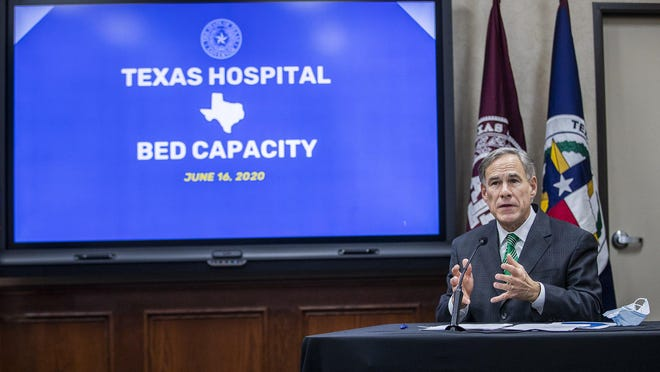 Gov. Greg Abbott speaks in mid-June at the Texas Department of Public Safety about hospital-bed capacity amid the COVID-19 pandemic. Texas hospitals are asking for the public's help in slowing the spread of COVID as hospitalizations are reaching the highest levels since the spike this summer.