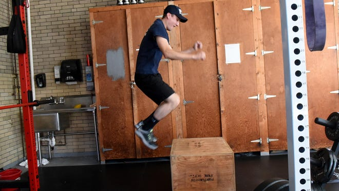 Parker Cutting is a probie at the Portsmouth Fire Department and is making use of the the gym available to firefighters which has now become a requirement for their wellness program.