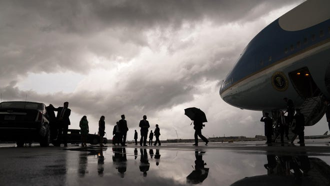President Donald Trump walks to his vehicle after arriving at Fort Lauderdale-Hollywood International Airport for a fundraiser, Friday, July 10, 2020, in Fort Lauderdale, Fla. Trump's re-election campaign postponed his scheduled rally in Portsmouth, N.H., on Saturday, July 11.