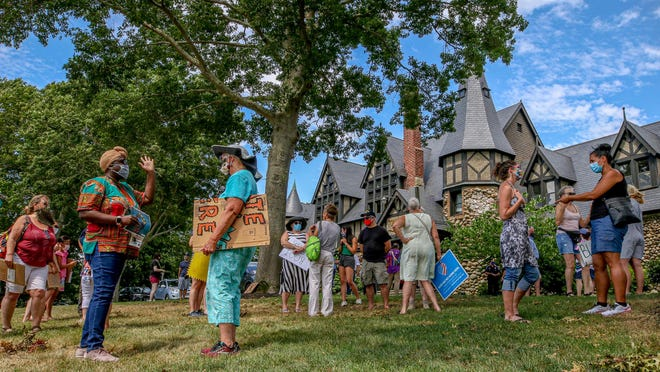 """Participants converse after Sunday's rally, which was an event called """"Community Support Against Hate Crimes and Racism,"""" on the front lawn of Barrington Town Hall."""