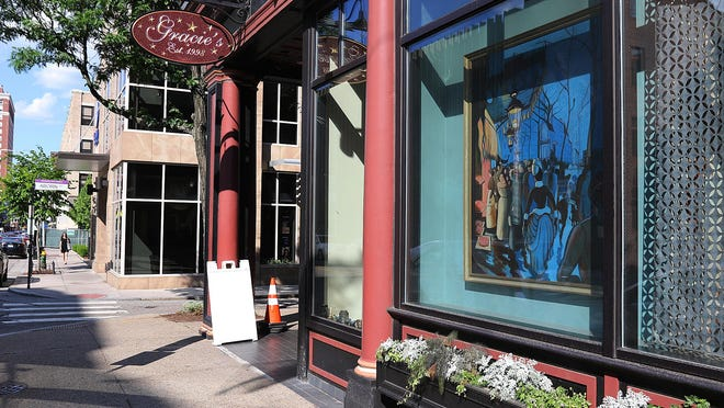 Gracie's, which now offers outdoor seating, is changing the way customers reward staff, with a new 20-percent service charge intended for all staff, not just servers.
