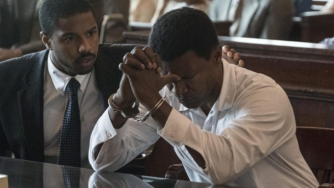 "Michael B. Jordan, left, as Bryan Stevenson and Jamie Foxx as Walter McMillian in ""Just Mercy."""