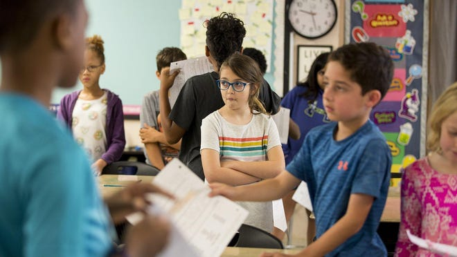 Gullett Elementary School student Talia Wilhelm last year participated in an activity in which fourth graders learned about the functions of the family as part of the Austin school district's human sexuality and responsibility curriculum. Texas is considering changes to its health standards, including sex education.
