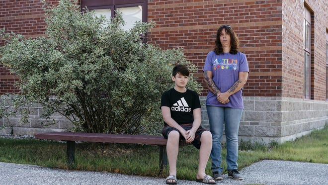 Remote learning during the coronavirus pandemic has been difficult for Valerie Patenaude and her son Chayce, pictured outside Buckfield Jr./Sr. High School, where Chayce is an eighth grader. Patenaude, a special education technician at the district's elementary school, said the experience has been more frustrating as a parent than as an educator. Chayce attended only one virtual class this spring because he is shy and didn't like participating in front of an audience of peers.