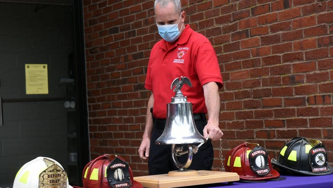 Rochester firefighter John Powers rings the bell during during a 9/11 ceremony Friday on the 19th anniversary of the terrorist attacks.