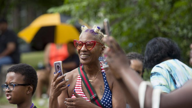 Sonia Anderson records a portion of the 2019 Juneteenth parade in Austin.