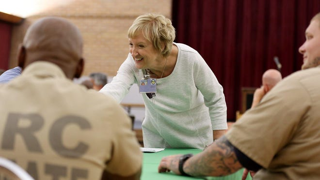 Christine Money, Kindway executive director and former prison warden, chats with inmates before a graduation for Embark participants at the Marion Correctional Institution in 2018.