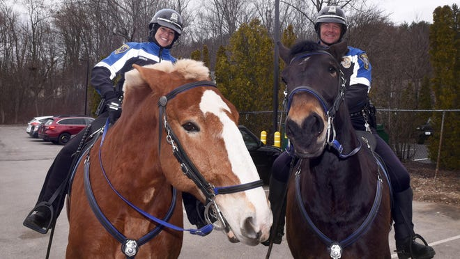 Dover Mounted Partrol officers Michelle Murch and Joe Caproni, seen with horses CJ and Rasa, worked together for 13 years before Murch's retirement in March 2020.