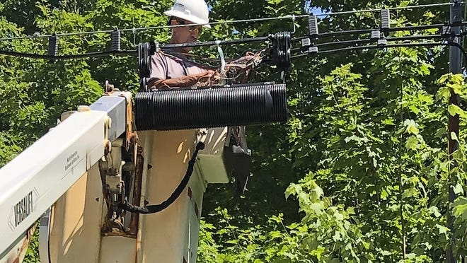 A Consolidated Communications technician works on a line used to provide broadband internet service in a rural area on Wednesday, July 29, 2020, in Stowe, Vt. Vermont officials are working to expand internet service using federal pandemic relief funds. But they are scrambling because the projects, which can frequently take years to plan and build, must be done by the end of the year.