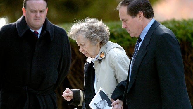 Patriots coach Bill Belichick, right, escorts his mother Jeannette as they leave the Naval Academy Chapel in Annapolis, Maryland., where they attended a funeral service for his father Steve Belichick in 2005.