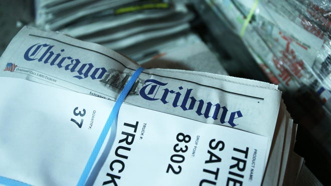 Bundles of Chicago Tribune Saturday editions are stacked for delivery at the Freedom Center.
