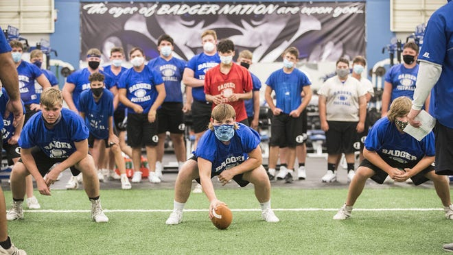 Lampasas center Avery Smith, preparing to snap the football during an August practice at the school, and his teammates have had their game this Friday canceled because of multiple COVID-19 positive test results this week.