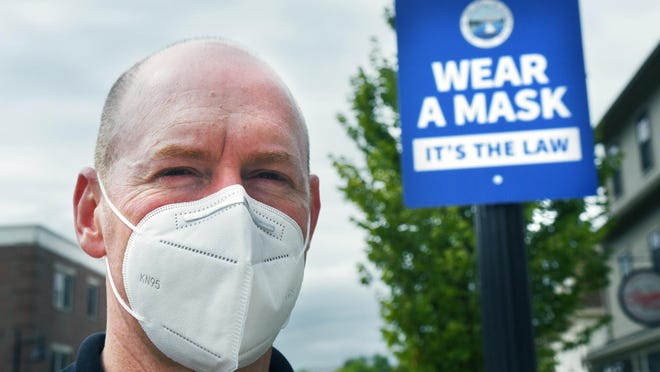 Durham Town Administrator Todd Selig reminds people that wearing masks is the law in town.
