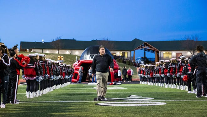 Tascosa head coach Ken Plunk enters the field before the game against Pebble Hills in the UIL 6A Division II Bi-District Championship on Nov. 15, 2019 at Dick Bivins Stadium.
