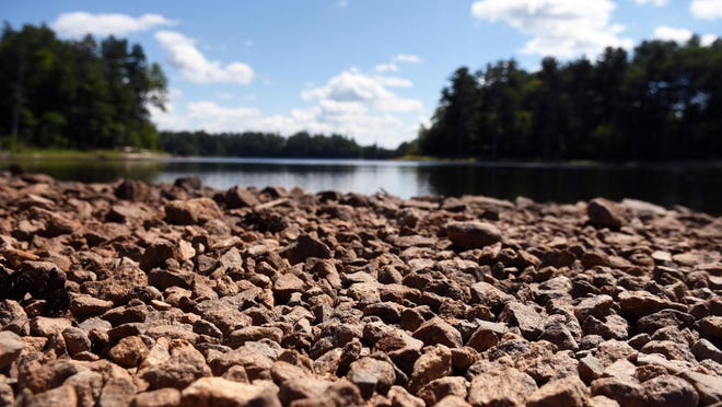 Rocks are exposed more than usual on the Dover side of Willand Pond as the Seacoast has experienced little rain this summer.