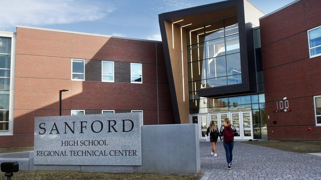 Students report to their first day of class in 2018 at the new Sanford High School and Sanford Regional Technical Center. Within the first couple of weeks of class in 2020, more than a dozen people associated with SHS and SRTC tested positive for COVID-19.