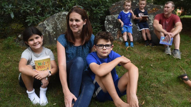 Meg Mazzola, center, and her two children Norah, 8, and Will, 10, began a neighborhood book club in Exeter during the pandemic.