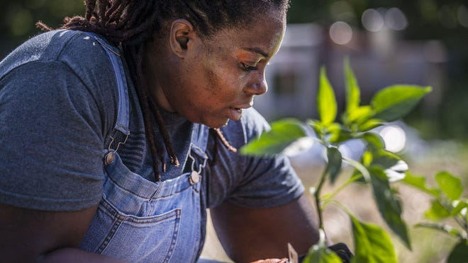 Tiffany Washington, shown Sept. 15, is a veteran who found solace for her PTSD in gardening, and through gardening, she discovered the history of black farmers in Austin.
