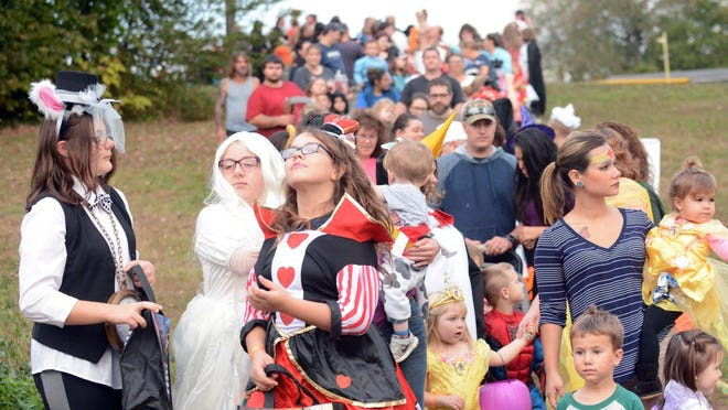 A long line of children and parents wait in line for candy to be handed out at Veterans' Park in Jewett City during Spooktopia in 2017. Children will be driven in vehicles during this year's Spooktopia at Hopeville Campground.