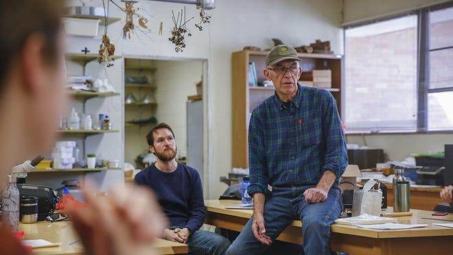 University of Texas biology professor Larry Gilbert is shown in February talking to students at UT' s Brackenridge Field Lab.