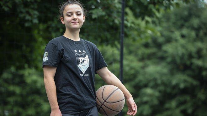 Hopedale star junior basketball player Bri Frongillo poses for a photo at her home in Hopedale on Saturday. Frongillo recently committed to play college basketball at Bryant University in Smithfield, Rhode Island.