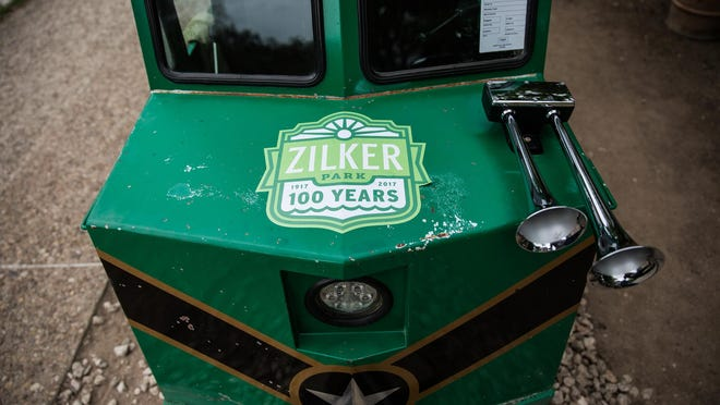 A sticker commemorating Zilker Park's 100th anniversary adorns the front of the Zilker Zephyr, Zilker's longtime miniature train, in 2017. The Zephyr has been removed and Austin Parks Foundation has released finalists for the name of a new train.