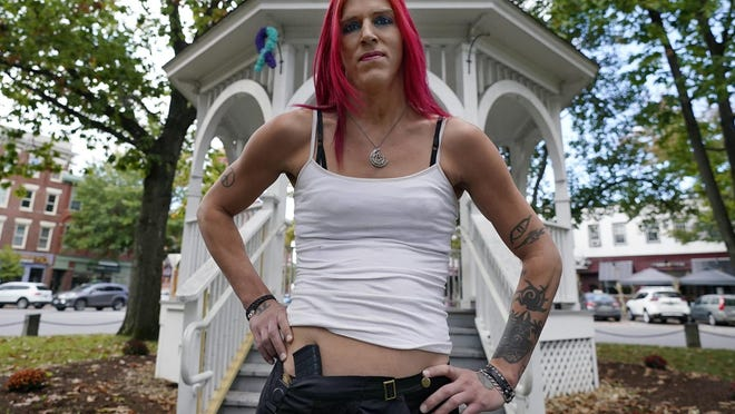 Aria DiMezzo, a Republican candidate for sheriff in Cheshire County, New Hampshire, poses at the Central Square gazebo, Tuesday, Oct. 6, 2020, in Keene. Republicans in the county are wrestling with the fact DiMezzo, who was nominated in last month's primary, is a transgender satanist whose campaign slogan disparages the police.