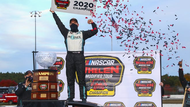 Justin Bonsignore, driver of the #51 Phoenix Communications Inc. Chevrolet, celebrates in victory lane after winning the Championship after the Sunoco World Series 150 for the NASCAR Whelen Modified Tour at Thompson Speedway Motorsports Park in Thompson, Connecticut on Sunday.