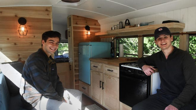 Durham friends Matthew Williams, left and Charlie Brooks are traveling across America in a 26-foot remodeled school bus.