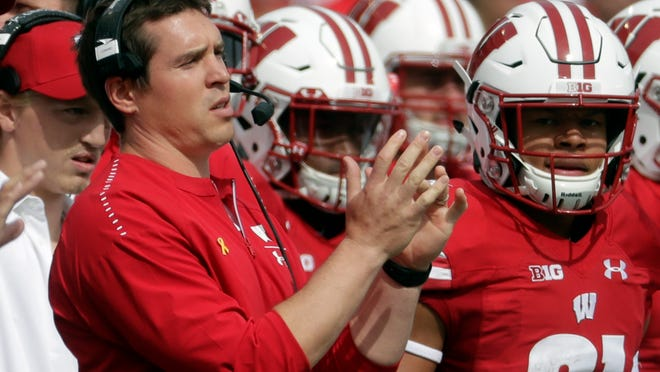Wisconsin defensive coordinator Jim Leonhard will remain with the Badgers.