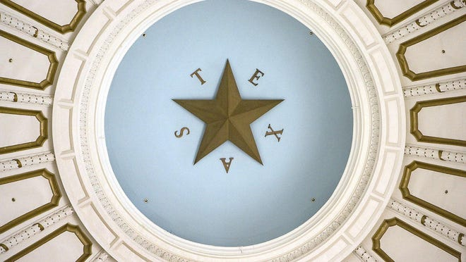 A star adorns the ceiling dome inside the rotunda of the Texas Capitol.