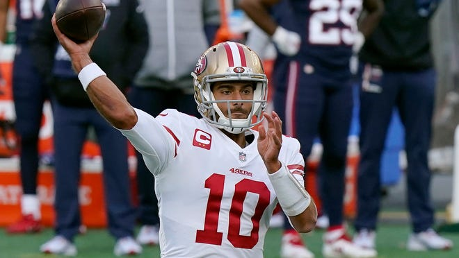 49ers quarterback Jimmy Garoppolo passes against the Patriots during the first half Sunday.