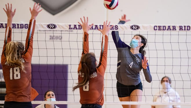 Alexis Ford of Cedar Ridge goes up for a shot against Erin Fagan and Mckayla Ross of Westwood during a District 25-6A contest Saturday at Westwood High School. Ford, who set a single-game school record for kills Friday against Vista Ridge, helped Cedar Ridge remain perfect in district play with the win over Westwood.
