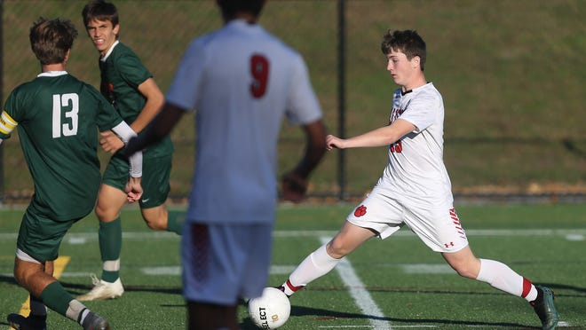 Holliston's Ben Siegel uses some footwork to get around the defense during the Tri-Valley League matchup against Hopkinton last fall. On Sunday, Siegel scored a goal in Holliston's win over Norton.