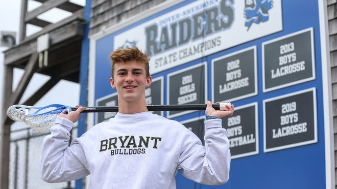 Dover-Sherborn lacrosse star Pierce Gregory poses for a photo at Dover-Sherborn High School in Dover on Saturday. Gregory recently committed to play lacrosse for Bryant University.