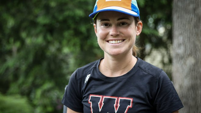 Wellesley resident Cassie Short poses for a photo in Wellesley on Saturday. Short was about to run in her fifth consecutive Boston Marathon before it was canceled because of COVID-19.