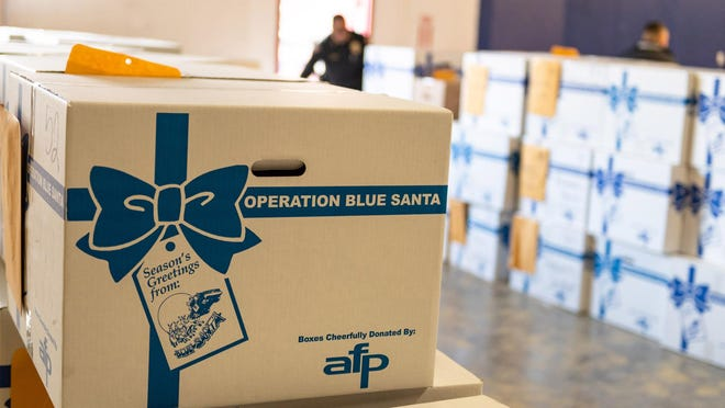 Jada from the Texas Baptist Children?s Home helps deliver gifts as part of the Pflugerville Police Department?s Operation Blue Santa program in 2017.