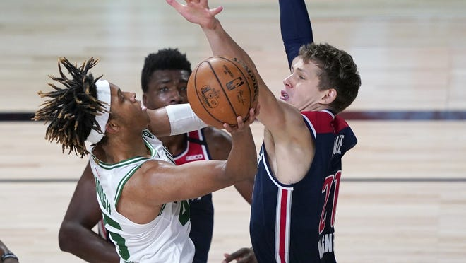 Boston Celtics' Romeo Langford, left, shoots as Washington Wizards' Moritz Wagner defends during the second half of an NBA basketball game Thursday, Aug. 13, 2020 in Lake Buena Vista, Fla.  at ESPN Wide World of Sports Complex.