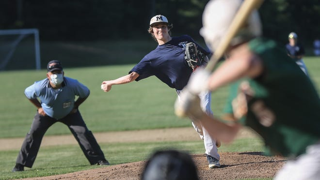 Medway's Eli Joyce-Vorce delivers a pitch during the Senior Babe Ruth game against Hopkinton at Medway High School in Medway on Monday. The umpire that usually stands behind home plate stood behind the pitcher's mound as a coronavirus precaution.
