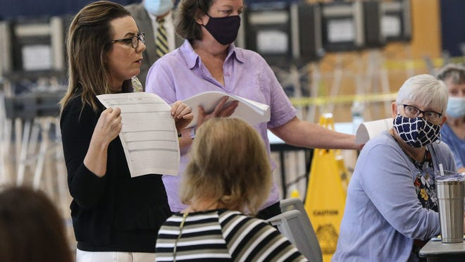 Michelle Tassinari, left, of the Office of the Secretary of the Commonwealth gives instructions to volunteers during the counting of uncounted ballots from the September 1 primary election at Franklin High School, Sept. 3, 2020.
