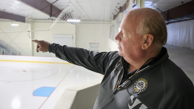 Wes Tuttle, shown giving a tour of the new rink facilities at New England Sports Center in Marlborough on Oct. 2, 2017, died in his Marlborough home on Saturday.