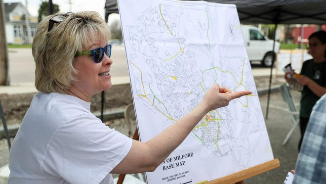 Geri Eddins, shown volunteering at Milford Beautification Day in 2017, is chair of the Milford Cultural Council.
