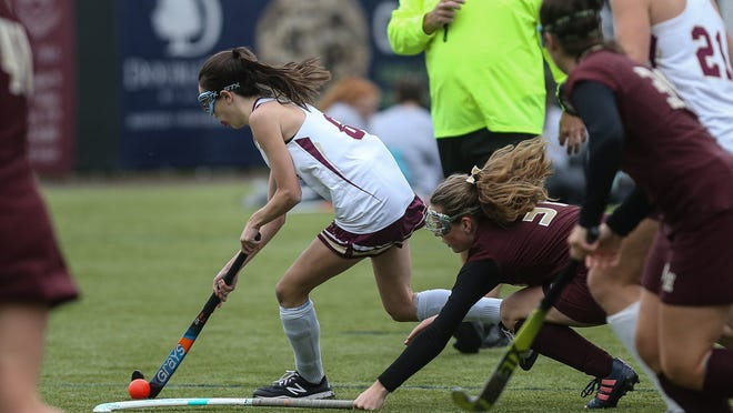 Algonquin's Grace Ammon drives to the goal and scores during a Midland-Wachusett League game against Shepherd Hill at New England Baseball Complex in Northborough last season. Ammon, along with teammate Sabrina Ferro, scored a hat-trick against Leominster on Friday.