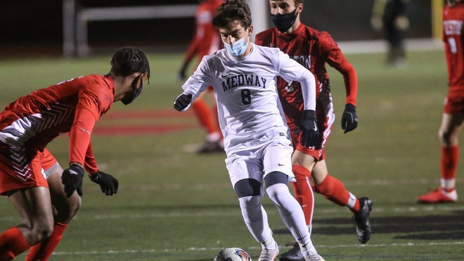 Medway's Christian Perugini takes control of the ball during a boys soccer game against Holliston at Holliston High School on Monday. The Mustangs won, 4-2, as Perugini scored a goal.